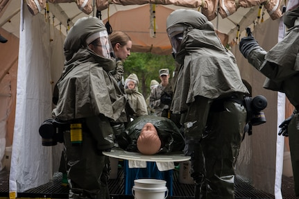Airmen from the 628th Medical Group prepare to move a simulated casualty during an exercise May 9, 2019, at Joint Base Charleston, S.C.