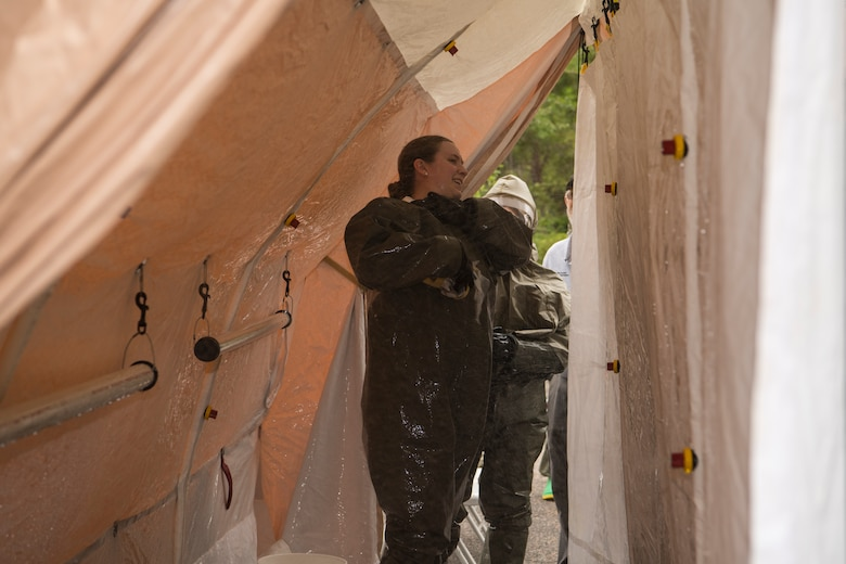 Senior Airman Kayla Morales, a dental assistant assigned to the 628th Aerospace Medical Squadron, decontaminates herself during an exercise May 9, 2019, at Joint Base Charleston, S.C.