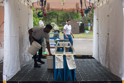 Airmen from the 628th Medical Group set up a decontamination tent during an exercise May 9, 2019, at Joint Base Charleston, S.C.