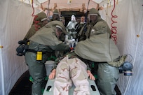 Airmen from the 628th Medical Group remove the clothes from a simulated casualty during an exercise May 9, 2019, at Joint Base Charleston, S.C.