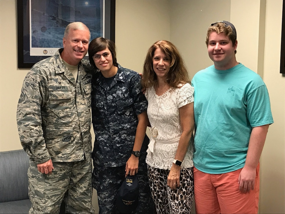 The Bailey family poses for a photo during a surprise visit from their daughter, a petty officer second class in the U.S. Navy. (Photo courtesy of Mrs. Lynne Bailey)