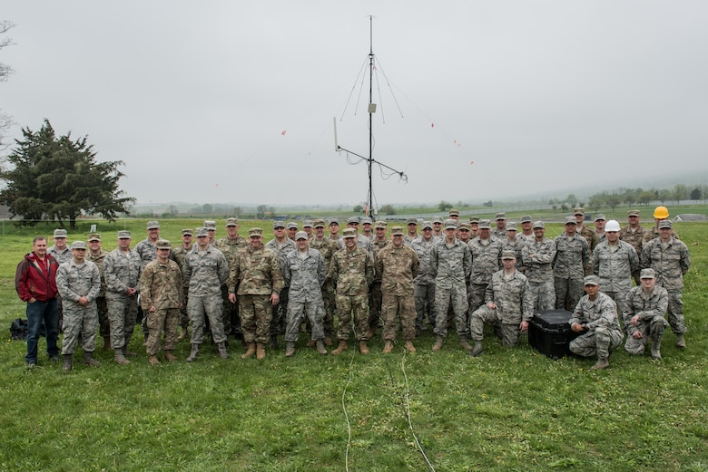 U.S. Airmen from various Air National Guard units, participate in a group photo