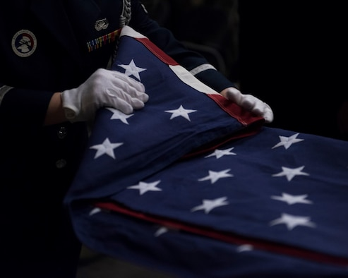 The Mountain Home Air Force Base honor guard conduct a ceremony April 5, 2019 at their ceremonial unit. The flag is folded as a part of a ceremony. (U.S. Air Force photo by Airman First Class Hailey Robertson)