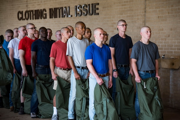Trainees line up for initial clothing issue May 1, 2019, at Joint Base San Antonio-Lackland, Texas. Between 300 and 400 trainees receive their first sets of uniforms weekly from initial clothing issue. (U.S. Air Force photo by Senior Airman Stormy Archer)
