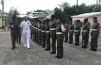 The commander of U.S. Southern Command, Navy Adm. Craig Faller, visits the headquarters of the Belize Defence Force.
