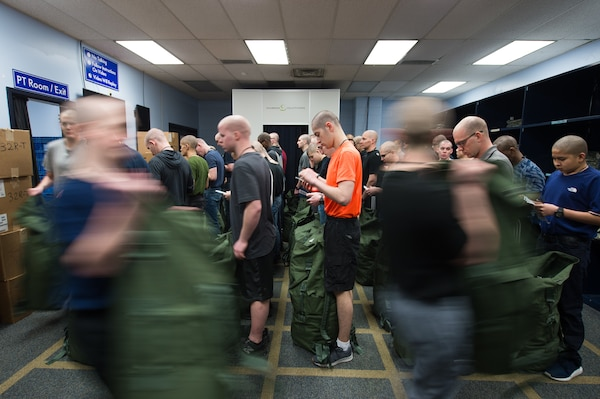 U.S. Air Force basic military training trainees receive their initial gear during clothing issue, Feb. 13, 2019, at Joint Base San Antonio-Lackland, Texas. The 502d LRS is responsible for issuing and fitting individual uniforms for more than 1,600 BMT trainees weekly. (U.S. Air Force photo by Sarayuth Pinthong)