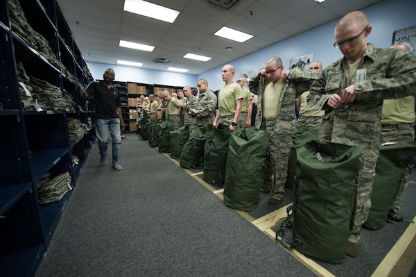 Cecil Harvey, 502d Logistics Readiness Squadron lead supply technician, helps with the sizing of uniforms during initial clothing issue, Feb. 13, 2019, at Joint Base San Antonio-Lackland, Texas. The 502d LRS is responsible for issuing and fitting individual uniforms for more than 1,600 BMT trainees weekly. (U.S. Air Force photo by Sarayuth Pinthong)