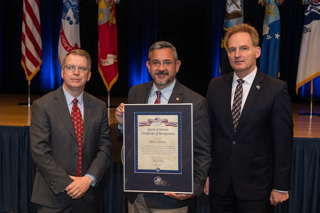 The Honorable David L. Norquist, performing the duties of The Deputy of the Secretary of Defense, and Sajeel S. Ahmed, Acting Director of Administration and Organizational Policy Office of the Chief Managment Officer, host the Spirit of Service Ceremony at the Pentagon in Arlington, Va., May 9, 2019. Mark Brown, the head of the U.S. Marine Corps' installation emergency management program, was recognized for his outstanding job performance and humanitarian work. (U.S. Army photo by Spc. Zachery Perkins)
