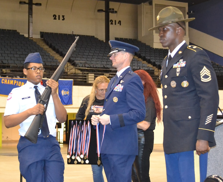 U.S. Air Force Brig. Gen. Christopher Niemi, Holm Center commander from Maxwell Air Force Base, Ala.,  presents a medal to Cadet Isaiah Watson, West Aurora High School, Ill., for his second place win in the Demilitarized Armed Knockout Competition at the National High School Drill Team Competition, May 3-5 2019, at Daytona Beach, Fla.  Cadet Watson beat out more than 500 cadets in a mass formation competition where cadets get 'knocked out' for not executing commands perfectly.