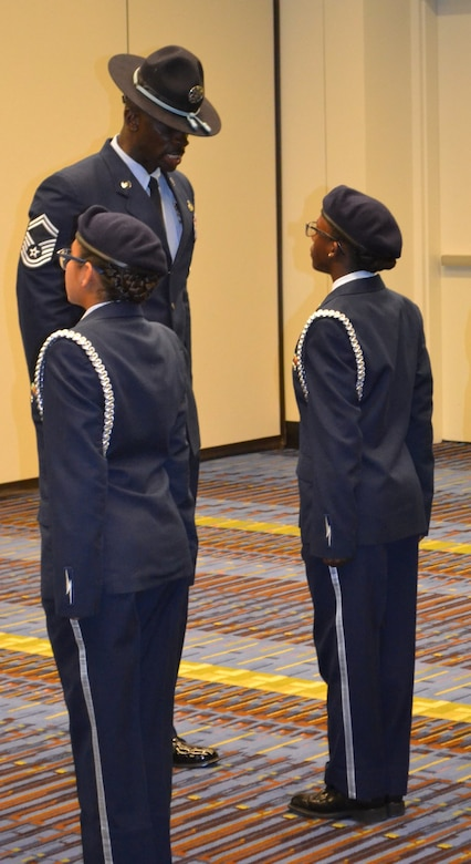 U.S. Air Force Senior Master Sgt. Gabriel Lewis, Officer Training School military training instructor from Maxwell Air Force Base, Ala., inspects cadets at the National High School Drill Team Competition, May 3-5 2019, at Daytona Beach, Fla.  Three MTIs from OTS participated as judges for the event to help determine which units would take home the top prize. The competition was a three-day event where 68 Junior Reserve Officer Training Corps drill teams from all services competed against each other for titles in more than 50 events.