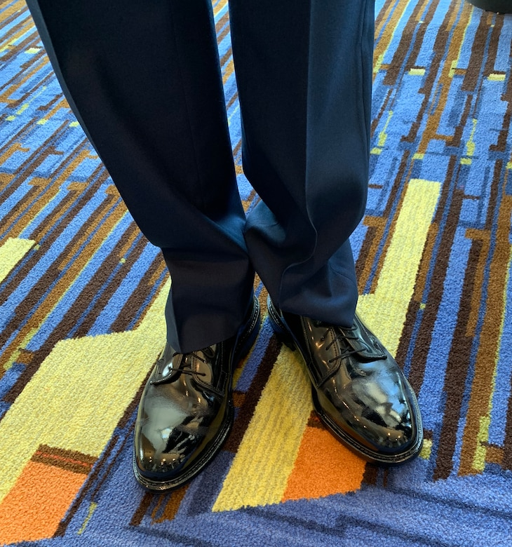 Air Force Junior ROTC Cadet Colton Moore, East Paulding High School, Ga., showcases his spit-shined dress shoes during the National High School Drill Team Competition May 3-5, 2019, at Daytona Beach, Fla. Cadet Moore took top honors and won the Demilitarized Armed Commander Trophy. Not only do cadets practice for hours after school on their drill performance, they also put in hours of work on every aspect of their uniform and personal grooming standards.