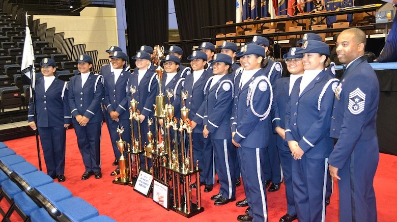 U.S. Air Force Chief Master Sgt. Jermaine Evans, Holm Center command chief, stands with the Silver Valor Air Force Junior Reserve Officer Training Corps cadets from Tom C. Clark High School, San Antonio, Texas, during the National High School Drill Team Competition May 3-5 2019, at Daytona Beach, Fla.  Silver Valor won trophies for five events and placed second overall in the unarmed competition.