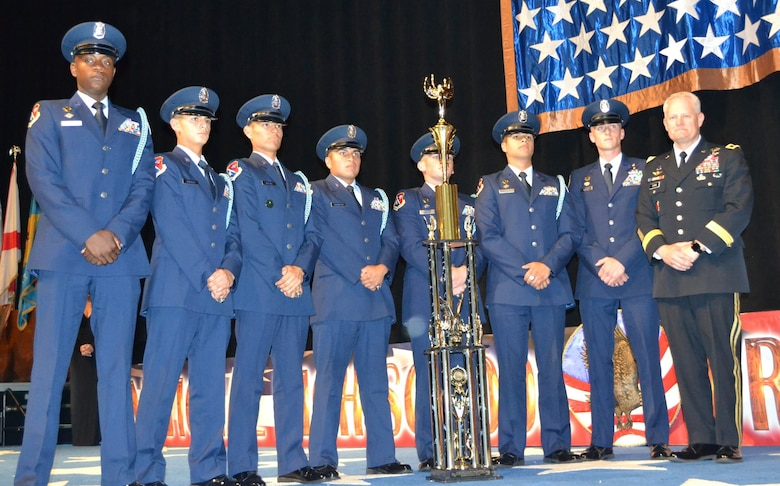 John Jay Silver Eagles from Jay High School in San Antonio stand together after winning their fourth national title in five years at the National High School Drill Team Competition, May 3-5, 2019, at Daytona Beach, Fla. The competition was a three-day event where 68 Junior Reserve Officer Training Corps drill teams from all services compete against one another for titles in more than 50 events.  U.S. Army Maj. Gen. John R. Evans Jr., Army Cadet Command commander, presented the Silver Eagles' trophy during the award ceremony.  In total, John Jay High School took home 22 trophies from the competition.