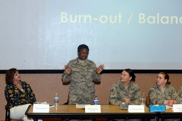 U.S. Air Force Master Sgt. Kimberly Collins, 55 Operation Support Squadron superintendent of host aviation resource management, speaks on burnout and balance during the Women Empowering Women seminar April 17, 2019, at Offutt Air Force Base, Nebraska. The seminar featured a panel of seven women who spoke on varied topics such as self-awareness, burnout and balance, reinventing yourself after trauma, overcoming adversity, finding your why and self-care. (U.S. Air Force photo by Kendra Williams)