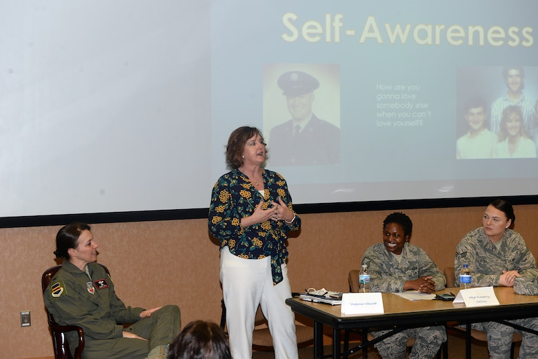 Virginia Wescott, 55 Wing Violence Prevention Integrator speaks on self-awareness during the Women Empowering Women seminar hosted at the 557th Weather Wing auditorium April 17, 2019, at Offutt Air Force Base, Nebraska. At one point the participants had a brief one minute meditation where they took a moment to focus on their breathing. Meditation is a form of self-empowerment and can be practiced regularly. (U.S. Air Force photo by Kendra Williams)