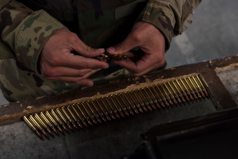 An Airman sets aside the correct amount of ammunition before loading it into their clip April 25, 2019, at Mountain Home Air Force Base, Idaho. Combat Arms Training and Maintenance Instructors put safety as their highest priority. (U.S. Air Force Photo by Airman 1st Class Hailey Bivens)