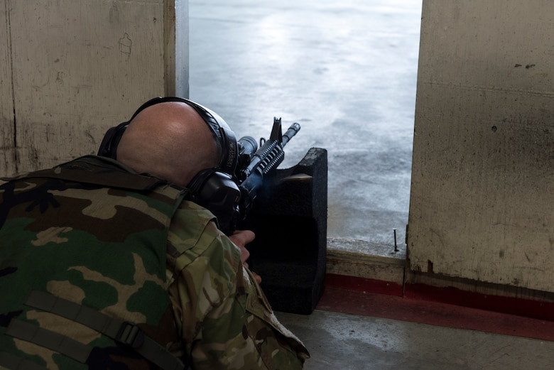 Tech Sgt. Joshua Armstrong, 366th Operations Support Squadron air traffic controller, fires his weapon in the prone position April 25, 2019, at Mountain Home Air Force Base, Idaho. Airmen learn how to safely operate weapons in the Combat Arms Training and Maintenance class. (U.S. Air Force Photo by Airman 1st Class Hailey Bivens)