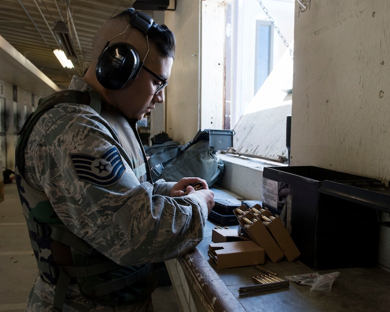 An Airman loads ammunition into his clip before receiving instructions April 25, 2019, at Mountain Home Air Force Base, Idaho. Airmen receive Combat Arms Training to ensure they are confident using their issued weapons. (U.S. Air Force Photo by Airman 1st Class Hailey Bivens)