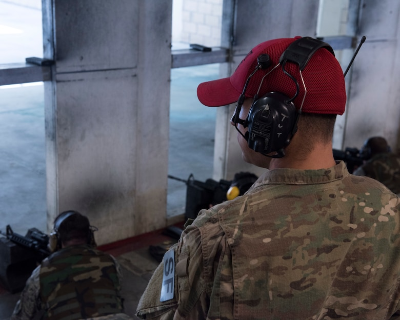 Staff Sgt. Justin Colmer, 366th Security Forces Squadron combat arms instructor, observes his students as they fire their weapons April 25, 2019, at Mountain Home Air Force Base, Idaho. Airmen learn how to safely operate issued weapons in the Combat Arms Training and Maintenance class. (U.S. Air Force Photo by Airman 1st Class Hailey Bivens)