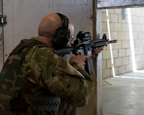 Tech Sgt. Joshua Armstrong, 366th Operations Support Squadron air traffic controller, fires his weapon in the kneeling supported position April 25, 2019, at Mountain Home Air Force Base, Idaho. Combat arms instructors assist their students throughout the Combat Arms Training and Maintenance class to ensure they are using the proper techniques.(U.S. Air Force Photo by Airman 1st Class Hailey Bivens)