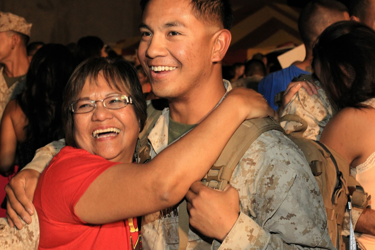 A soldier reunites with his mother.