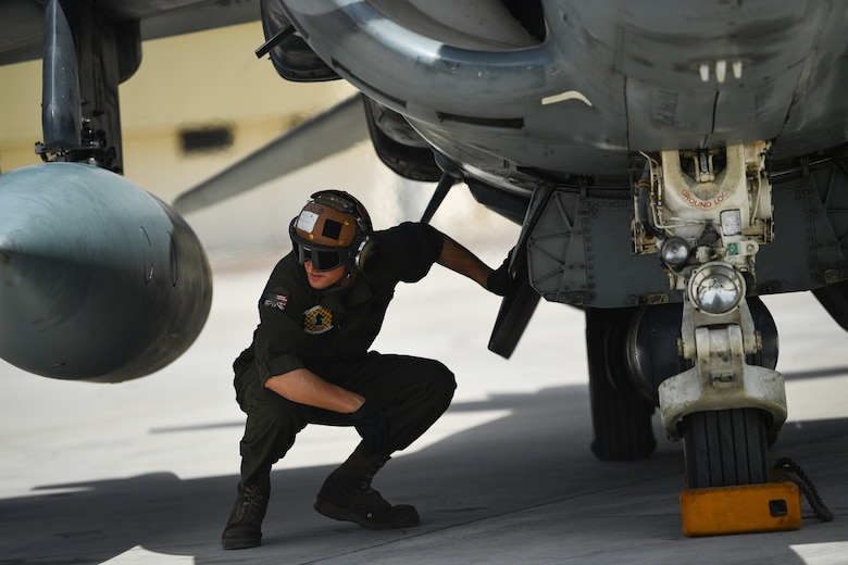 A U.S. Marine conducts pre-flight checks on an AV-8B Harrier II during Desert Flag 19-2 in Southwest Asia, April 28, 2019. Desert Flag is designed to exercise combined Air Forces in military operations to enhance competence and strengthen military-to-military relationships and regional security.