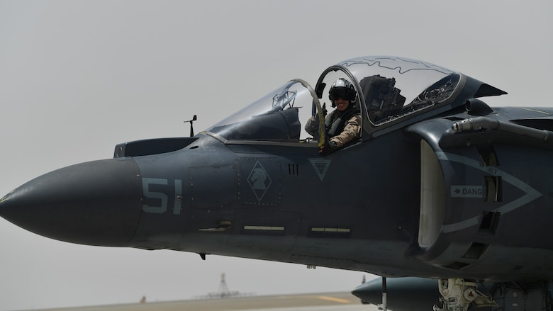 A U.S. Marine waves while taxiing in an AV-8B Harrier II during Desert Flag 19-2 in Southwest Asia, April 28, 2019. Desert Flag is designed to exercise combined Air Forces in military operations to enhance competence and strengthen military-to-military relationships and regional security.