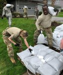 New York Army and Air National Guard personnel conduct sandbagging operations near Sodus Point, N.Y. on May 7, 2019, as part of the New York National Guard participation in New York state response to flooding along the Lake Ontario shoreline. The lake is two feet higher than normal water levels and New York Gov. Andrew M. Cuomo has directed the mobilization of 200 National Guard personnel to assist.