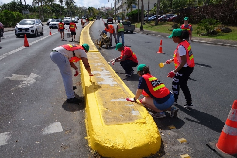 The Guam Visitors Bureau (GVB) has teamed up with the Department of Public Works (DPW) and volunteers from the Andersen Air Force Base Sister Village Program to water blast and paint medians as part of efforts to beautify and improve traffic safety in Tumon.