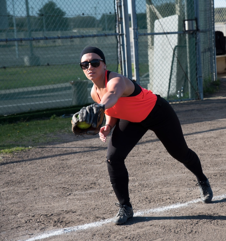 U.S. Air Force Staff Sgt. Danielle Clemons, a 35th Medical Operations Squadron primary care office manager, warms up before the 2019 Cinco de Mayo softball tournament by catching and throwing pitches at Misawa Air Base, Japan, May 4, 2019. Five teams competed giving Airmen the opportunity to connect with others and build team cohesion. (U.S. Air Force photo by Branden Yamada)