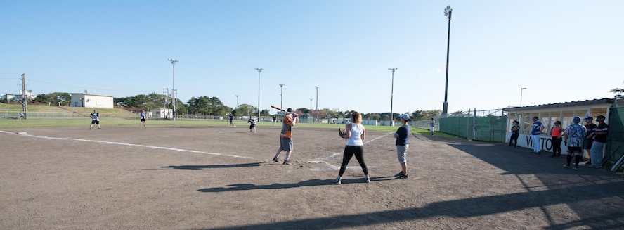 The 35th Security Forces Squadron and 35th Medical Operations Squadron compete in a match during the 2019 Cinco de Mayo softball tournament at Misawa Air Base, Japan, May 4, 2019.  Both teams played the opening match for the tournament, garnering spectators and supporting relations with neighboring units on Misawa Air Base. (U.S. Air Force photo by Branden Yamada)