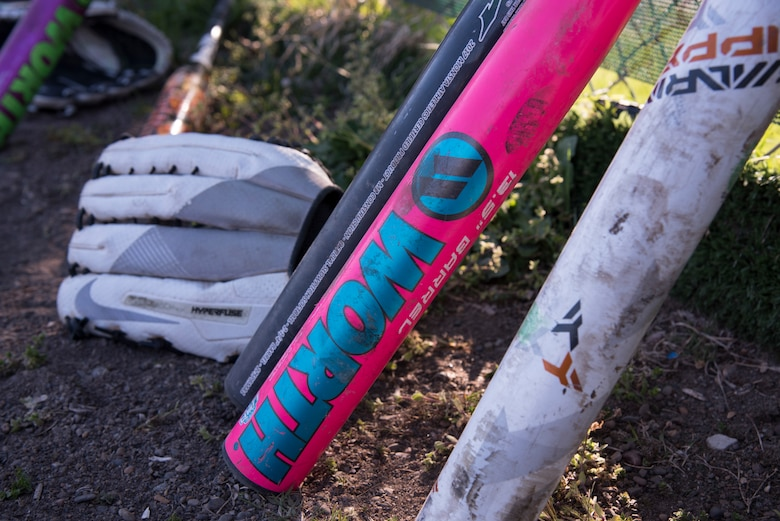 Softball equipment rests on a fence beside the dugout during a 2019 Cinco de Mayo softball tournament at Misawa Air Base, Japan, May 4, 2019. Five teams participated in the tournament supporting readiness and team cohesion. (U.S. Air Force photo by Branden Yamada)