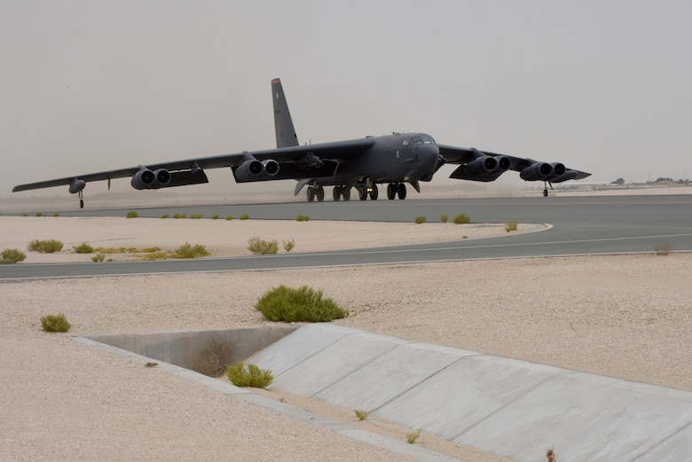 A photo of B-52 bomber taxiing on a runway.