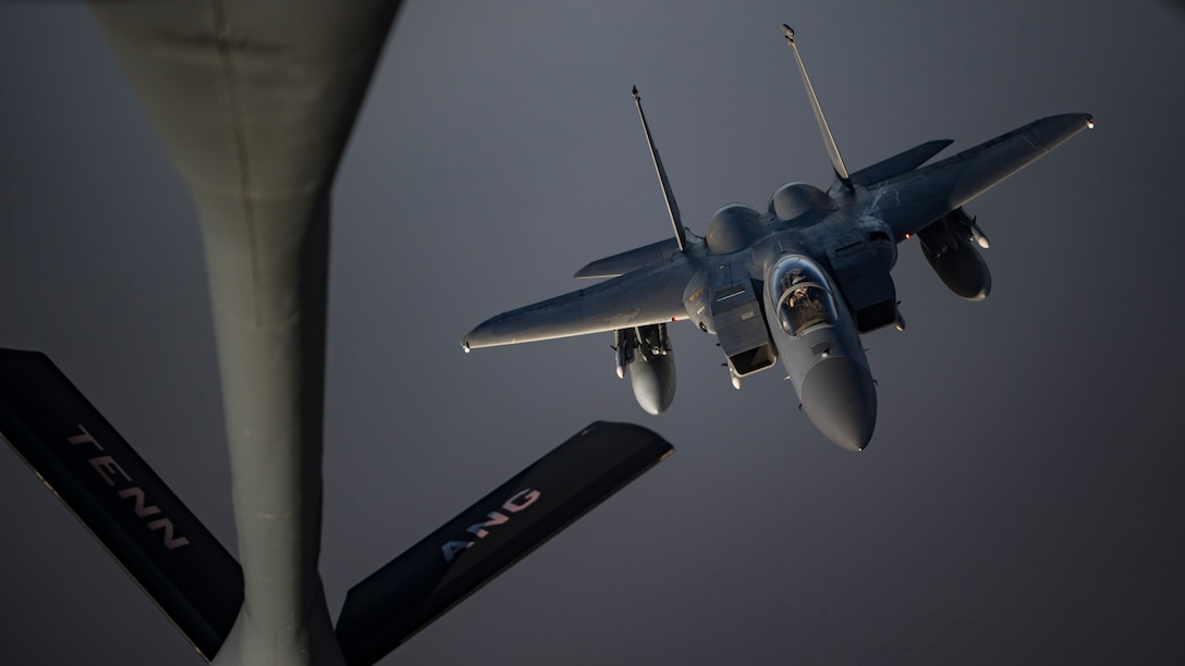 A photo of F-15 preparing to midair refuel.
