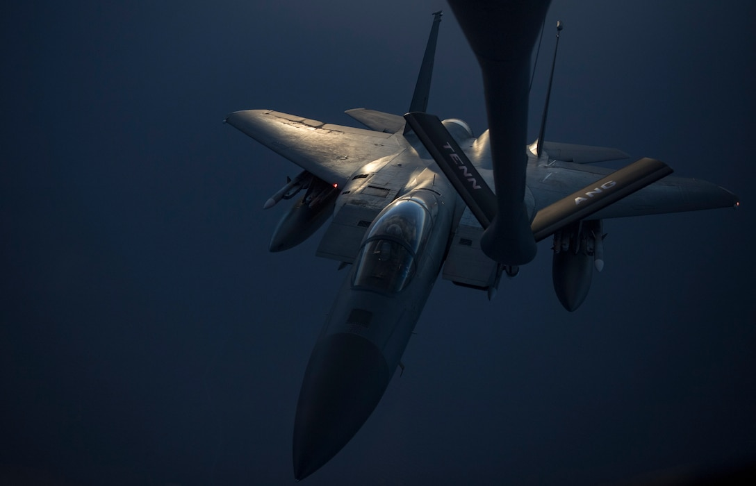 A photo of an F-15C Eagle performing a midair refueling.