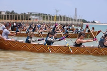 Members of the local and U.S. communities on Okinawa took part in Dragon Boat Races May 12, 2019, in Henoko, Okinawa, Japan. Three American teams made to the women's final and there were waiting for a signal to start the race.