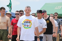 Members of the local and U.S. communities on Okinawa took part in Dragon Boat Races May 12, 2019, in Henoko, Okinawa, Japan.  A team from Camp Schwab, led by Col. Jason S.D. Perry, Camp Schwab commanding officer, prepare to start a race in the men's division competition.
