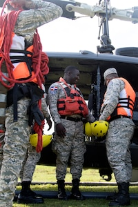 Members of the Dominican Republic Air Force search and rescue squadron prepare for a water-rescue exercise as part of a simulated flood-response within Fuerezas Aliadas Humanitarias 2019 near Bajo Yuna, Dominican Republic May 9, 2019.