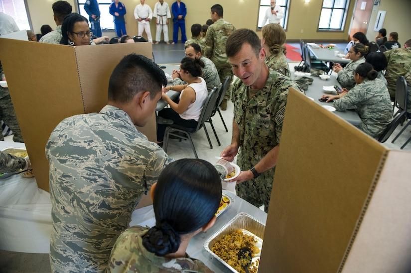 U.S. Navy Captain Kevin Byrne, Joint Base Charleston deputy commander, tries some of the different food samples offered during the Asian American Pacific Islander Heritage Month Cultural Showcase on May 7, 2019, at the Air Base Chapel.