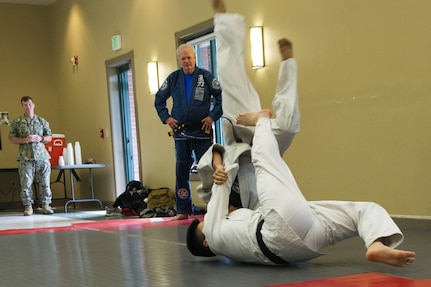 Nuclear Electronics Technician 3rd Class Austin Hronek, Navy Nuclear Power Training Command student, bottom, demonstrates Judo and Ju-Jitsu martial arts during the Asian American Pacific Islander Heritage Month Cultural Showcase on May 7, 2019, at the Air Base Chapel.