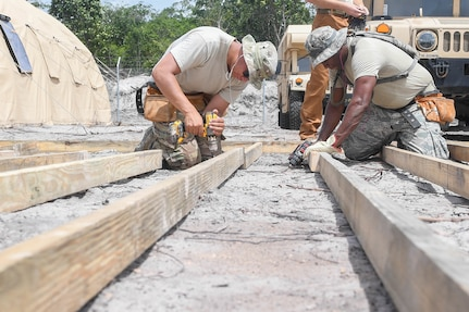 U.S. Air Force Airmen construct flooring for the kitchen tent during New Horizons exercise 2019 at Camp Seweyo, Guyana, May 11, 2019.