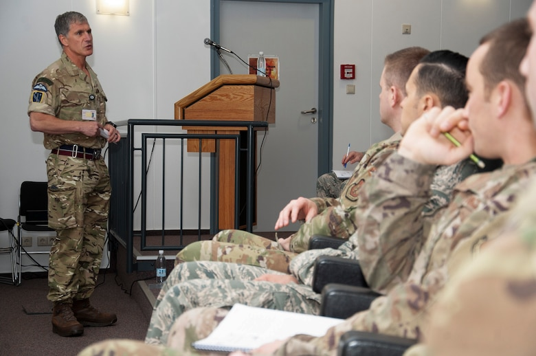 Chief Warrant Officer Jake Alpert, command senior enlisted advisor for NATO Allied Air Command, speaks to junior noncommissioned officers during the Atlantic Stripe.