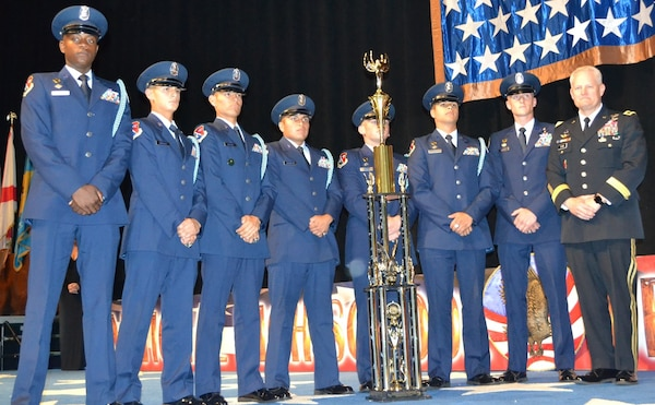 The John Jay Silver Eagles from Jay High School in San Antonio stand together after winning their fourth national title in five years at the National High School Drill Team Competition, May 3-5, 2019, at Daytona Beach, Florida. The competition was a three-day event where 68 Junior Reserve Officer Training Corps drill teams from all services compete against one another for titles in more than 50 events. U.S. Army Maj. Gen. John R. Evans Jr. (right), Army Cadet Command commander, presented the Silver Eagles' trophy during the award ceremony. In total, John Jay High School took home 22 trophies from the competition.