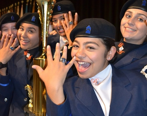 Air Force Junior Reserve Officer Training Corps cadets from Louis D. Brandeis High School, San Antonio, Texas, showcase the rings they received from the 2018 National High School Drill Team Competition following their 2019 victory in the same event May 3-5 2019, at Daytona Beach, Florida. The cadets were the first team in 35 years to accomplish consecutive victories in the competition.
