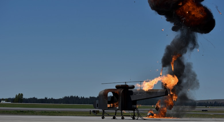 A helicopter crash trainer from Joint Base Lewis McChord, Washington, is on fire while Team Fairchild simulated an explosion during a Major Accident Response Exercise at Fairchild Air Force Base, May 9, 2019.