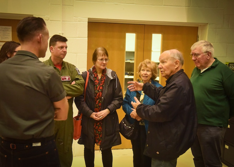 Retired U.S. Air Force Col. Thomas Domingues speaks with friends, family and a pilot about his Air Force career during a visit at RAF Mildenhall, England, May 10, 2019. Domingues flew aerial refueling missions in the KC-135 during the Vietnam War and visited the base as part of a surprise visit set up by his friends and family. (U.S. Air Force photo by Airman 1st Class Joseph Barron)