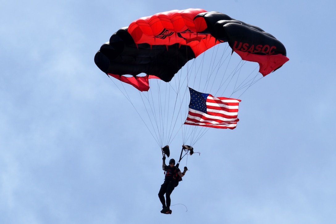 A solider parachutes during a performance.