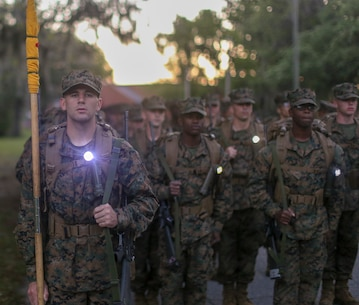 Recruits with Alpha Company, 1st Recruit Training Battalion, conduct a 5K Hike on Apr 20, 2019 on Marine Corps Recruit Depot Parris Island, S.C. The recruits will conduct five hikes of increasing difficulty before culminating in a 15K hike during the Crucible. Today approximately 19,000 recruits come to Parris Island annually for the chance to become United States Marines by enduring 12 weeks of rigorous, transformative training. (U.S. Marine Corps photo by Cpl. Daniel O'Sullivan/Released)