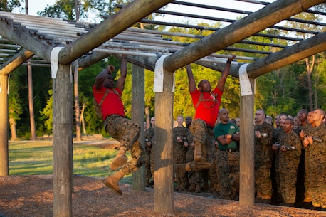 Drill Instructors with Alpha Company, 1st Recruit Training Battalion demonstrate an obstacle for recruits during the Confidence Course at Leatherneck Square on Parris Island S.C., April 23, 2019. The course is comprised of 15 obstacles designed to help recruits build confidence by overcoming physical and mental challenges. Parris Island has been the site of Marine Corps recruit training since Nov. 1, 1915. Today, approximately 19,000 recruits come to Parris Island annually for the chance to become United States Marines by enduring 13 weeks of rigorous, transformative training. Parris Island is home to entry-level enlisted training for approximately 49 percent of male recruits and 100 percent of female recruits in the Marine Corps. (U.S. Marine Corps photo by Cpl. Isabella Ortega/Released)