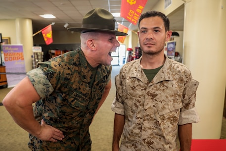 NASCAR driver Kyle Larson gets yelled at by a Sgt. Eric Charpentier aboard Marine Corps Recruit Depot Parris Island, S.C., April 28, 2019. Larson visited the depot in preparation for the Coca Cola 600 race at Charlotte Motor Speedway held during Memorial Day weekend. Larson will drive a race car in honor of the Marine Corps. (U.S. Marine Corps photo Cpl. Andrew Neumann/Released)